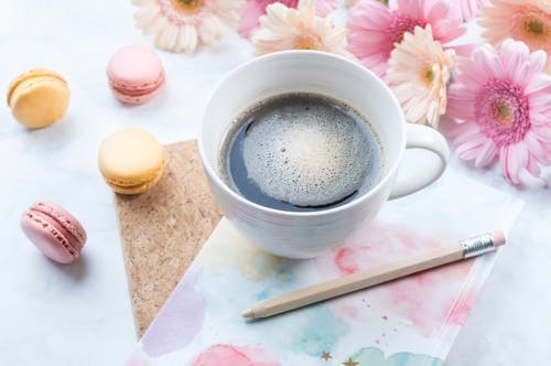 Black Coffee And Macarons On A Table