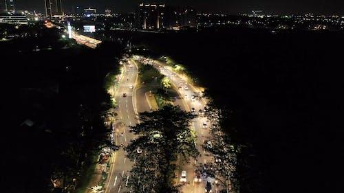 Vehicles Passing Through An Illuminated Bridge