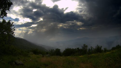 Dark Clouds Above A Mountain In Timelapse Mode