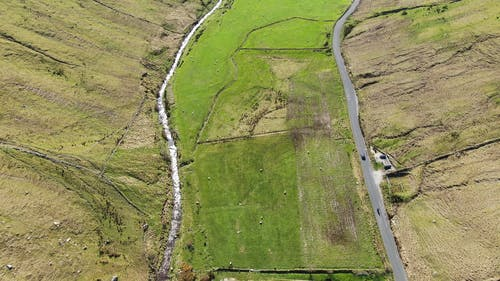 Aerial View Of Vehicles Travelling Across The Valley