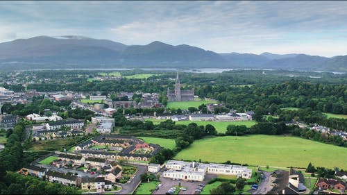 Aerial Footage Of A Town Surrounded By Scenic Natural Landscape