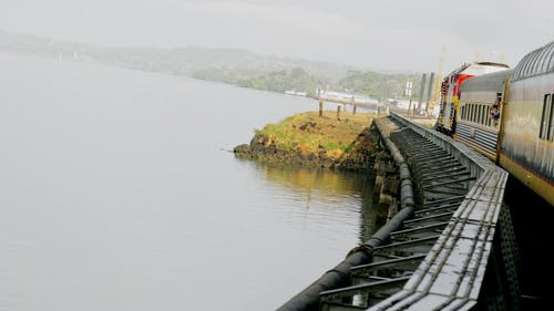 Train Travelling Near A Body Of Water