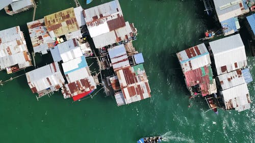 Aerial Footage Of Stilted Houses Build On Shallow Waters