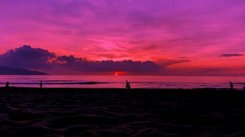 People On The Beach At Sunrise