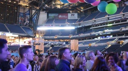 People Celebrating Inside An Arena