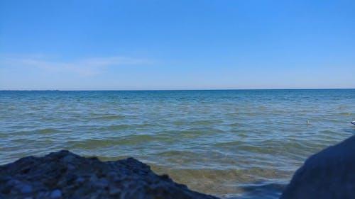 Beautiful Horizon On Water Under Blue Sky
