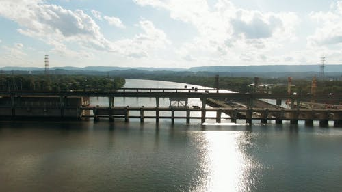 Aerial Footage Of A Bridge And Its Surrounding Landscape