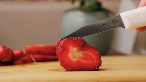 Strawberry Being Sliced
