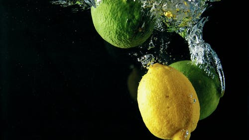 Dropping Lemons In Water