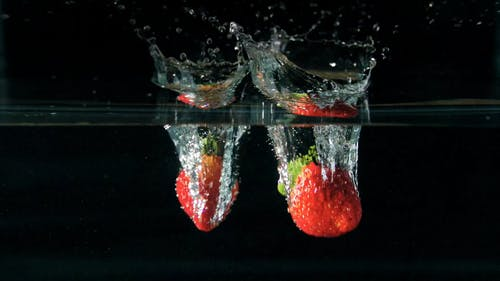 Strawberries Plunging Into Water
