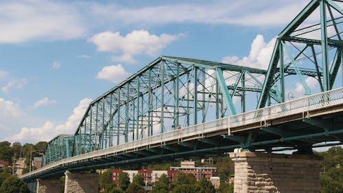 A Walking Bridge Across A Body Of Water