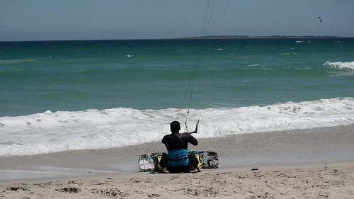 A Man Kite Surfing In The Sea