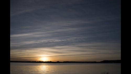 Time Lapse Footage Of The Skies Over A Lake From Dusk To Dawn