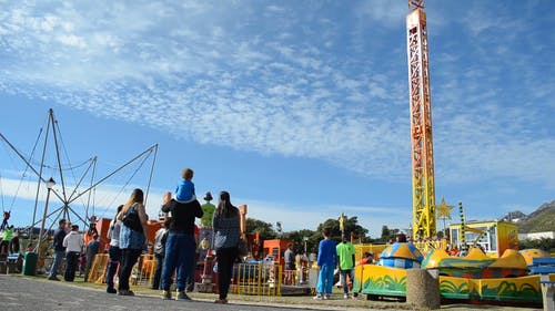 People Enjoying An Amusement Park