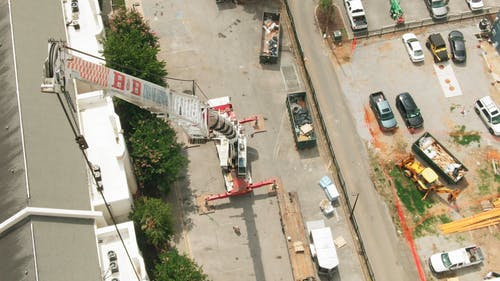 A Crane In Operation At A Construction Site