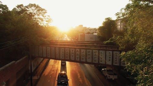 Drone Footage Of A City Road Under A Bridge