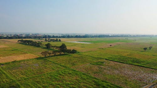 Aerial Footage Of Vast Agricultural Land In A Rural Area