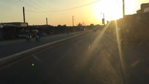 Speeding On A Road At Sundown