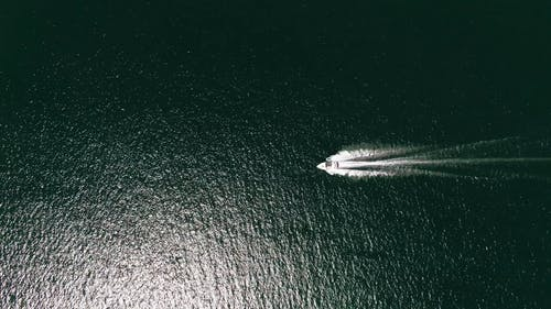 A Speedboat Traversing A Lake