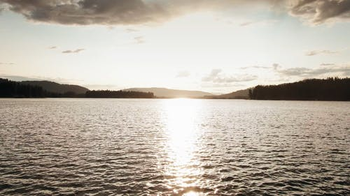 Sun Rays  On The Surface Of A Lake