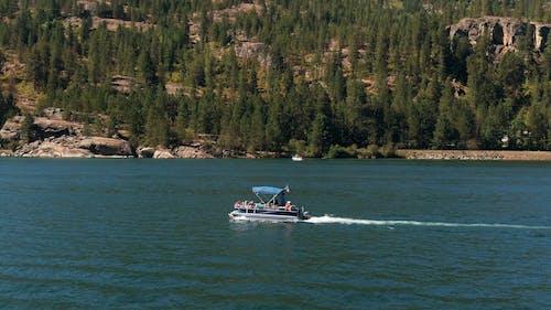 A Motor Boat Traversing A Lake
