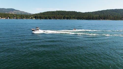 People Enjoying A Fun Ride On A Speedboat