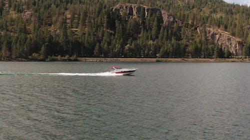 A Speedboat Traversing A Lake