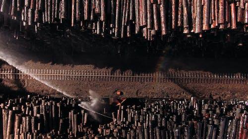 Water Sprinklers In A Lumber Yard