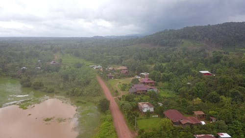 Aerial Footage Of A Village In A Rural Area And Its Surrounding Natural Landscape