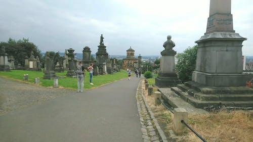 People Visits A Graveyard