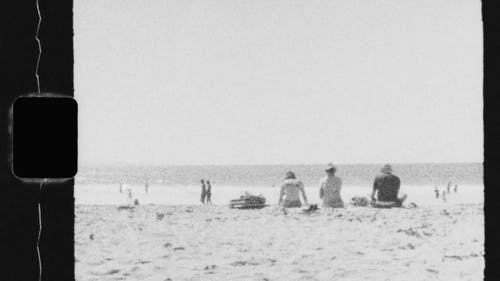 Black-And-White Footage Of People Enjoying The Beach