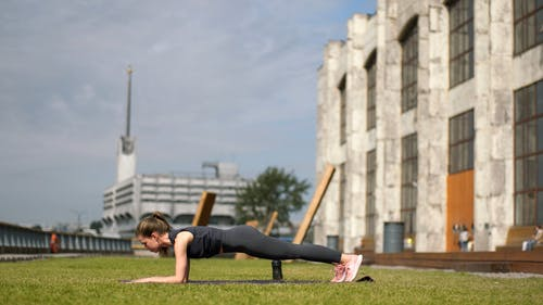 Woman Doing Push-Up And Stretching Exercise