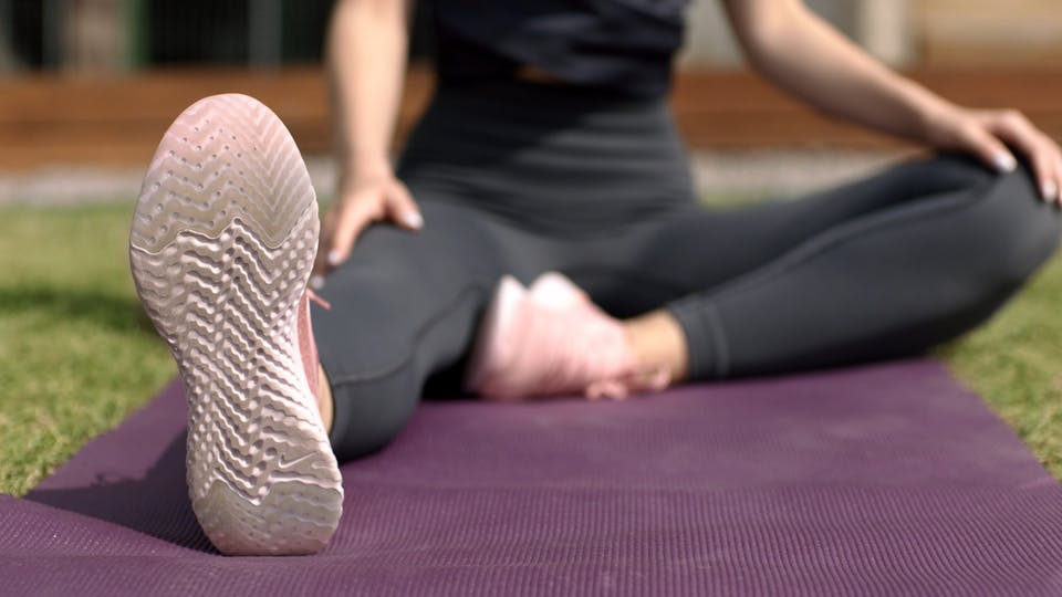 Woman Demonstrating A Stretching Exercise
