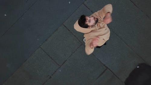 Man Wearing Hoodie On Top Of Building