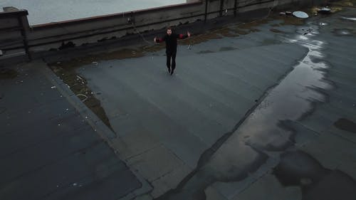 Man Dancing Hip-Hop On Rooftop