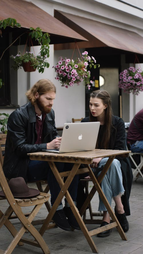 Man And Woman Discussing Work Outdoors