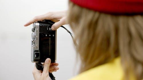 Woman Setting Her Camera
