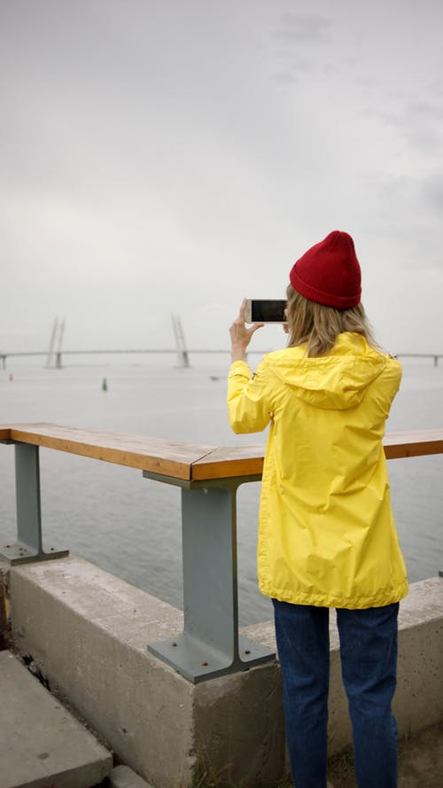 Woman Taking A Photo Using Her Smartphone