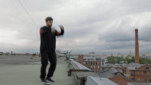 Man Dancing Hip-Hop On A Rooftop