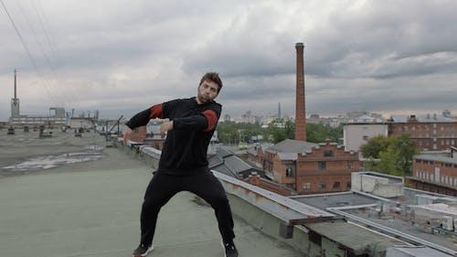 Man Dancing On Rooftop