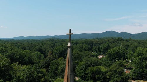 Drone Footage Of A Cross On Top Of A Church
