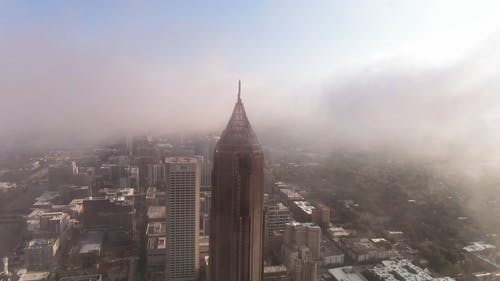 Aerial Footage Of Clouds Surrounding A Skyscraper