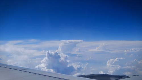 View Of Cloud Formations From An Airborne Aircraft Window