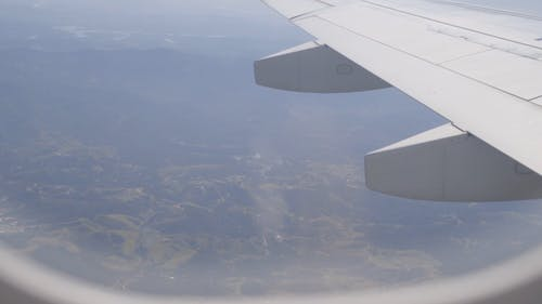 The Wing Of An Airplane On Flight