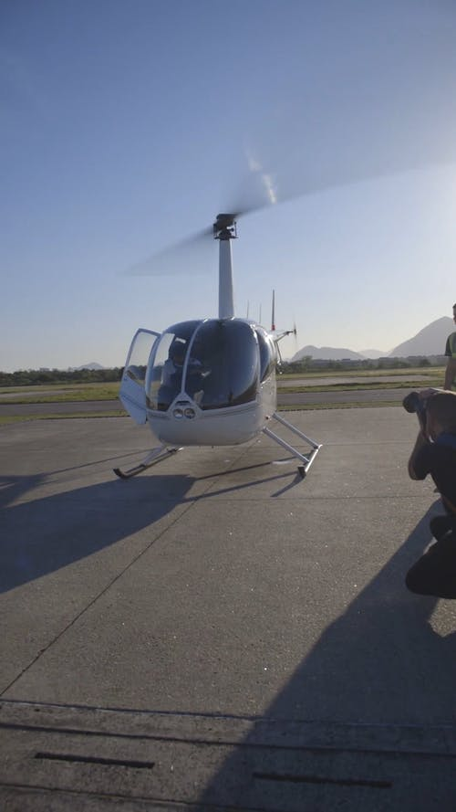 Photo Shoot Of A Man Inside A Landed Helicopter