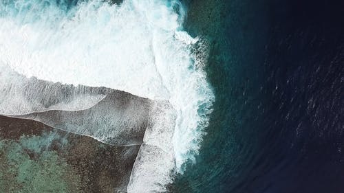 Slow Motion Footage From Above Of Waves Breaking  On The Reefs
