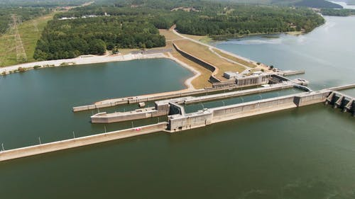 Aerial Footage Of A Huge Dam And Its Surrounding Landscape