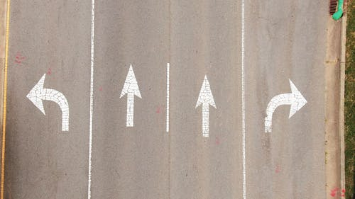 Painted Arrows In A Road For Direction