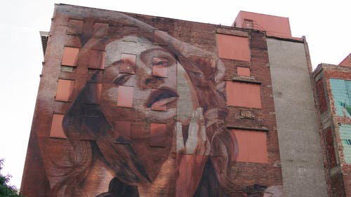 Low Angle Footage Of Buildings With Painted Murals