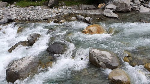 A River Cascading On Bed Of Rocks
